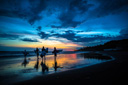 Title: Surfers at Sunset Photo Of: stock Type: Sunsets