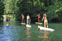 Title: Stand Up Paddling Under Bridge Photo Of: stock Type: Stand Up Paddle